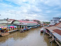 THAILAND, SAMUTSONGKHRAM - JUNE 17,2018:People shopping and eating at Amphawa floating market in Thailand.The destination for tour stock photography