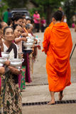 Buddhist monks at their morning almsround Stock Photos