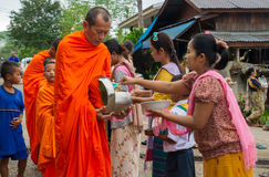 Buddhist monks at their morning almsround Stock Images