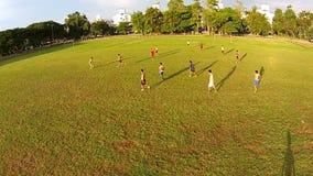 Thailand - Sep 26,2014: Naresuan University Stadium. Thai students play Football Funny. Video shot from a drone show aerial view of Thai students play football stock video