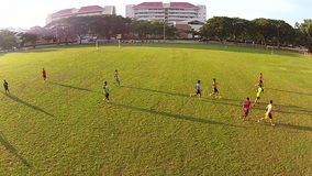 Thailand - Sep 26,2014: Naresuan University Stadium. Thai students play Football Funny. Video shot from a drone show aerial view of Thai students play football stock video footage