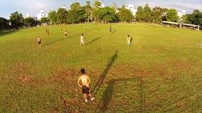 Thailand - Sep 26,2014: Naresuan University Stadium. Thai students play Football Funny. Video shot from a drone show aerial view of Thai students play football stock footage