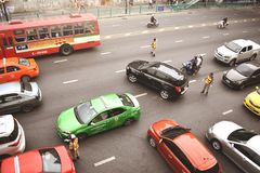 Traffic Police Regulating Traffic on City Street, Bangkok Thailand royalty free stock photography