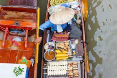 Thailand small boats laden with colourful fruits and vegetables and paddled by Thai women Royalty Free Stock Images