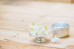 Thailand Songkran festival decoration concept,. Water in silver bowl with jasmine white flower Stock Image