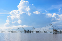 Thailand southern local fishing tool called `Yor` located in Thale Noi, Phatthalung, Thailand with beautiful blue sky and cloud royalty free stock images