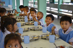 Thailand students eat. Ing in the school cafeteria Royalty Free Stock Images