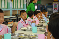 Thailand students eat. Ing in the school cafeteria Royalty Free Stock Photos