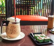 Thailand style iced coffee with dessert. Stock Photos
