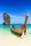 Thailand summer travel sea, Thai old wood boat at sea beach Krabi Phi Phi Island Phuket. Park on white sand blue sky emerald green ocean water Stock Photos