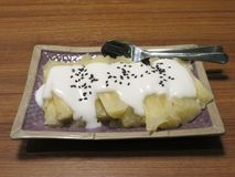 Thailand sweet dessert. Sweet cassava with coconut milk Stock Photography