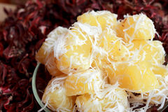 Thailand sweets - candy, boiled potatoes sprinkled with coconut. Royalty Free Stock Images