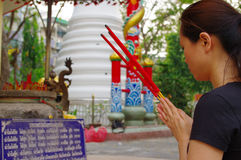 Thailand temple. Woman in a place for worship Stock Photos
