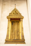 Thailand temple doors, windows, gold, old, beautiful, heritage T Royalty Free Stock Images