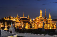 Thailand temple travel Grand palace Emerald Buddha Wat Phra Kaew at twilight Blue Sky from traffic in Bangkok, Thailand. Thailand temple travel Grand palace stock image
