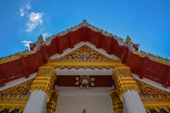 Thailand temples carved. In gold on blue sky background Stock Photos
