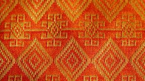 Thailand textile. Thailand traditional textile - orange style Stock Image