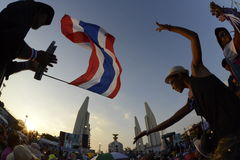 THAILAND. Thai anti-government protesters wave national flags during a rally at the Royalty Free Stock Photos