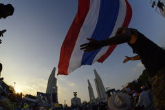THAILAND. Thai anti-government protesters wave national flags during a rally at the Stock Photo