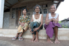Thailand with three woman in front of there houses Stock Images