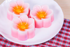 Thailand tradition ,Flower Dessert Coconut Jelly on wood Stock Photos
