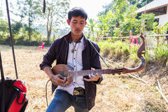 Thailand traditional musician playing folk music Stock Image