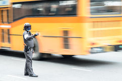 Thailand traffic police. A thai traffic police officer on duty at an intersection Stock Images