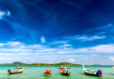 Thailand tropical beach exotic landscape. With wooden boats Stock Photography