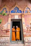Thailand Two novices are standing reading books together in the Stock Photography