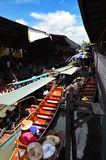 Thailand is a very popular and touristy, floating market in waterways in Bangkok. Thailand is a very popular and tourist floating market on the waterways in royalty free stock photo