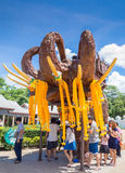 Thailand, Wat Huay Mongkol 2015-may-30: people Pray around elephant statue Royalty Free Stock Photos