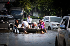 Thailand water flood. BANGKOK, THAILAND - NOVEMBER 5 : flood hits Central of Thailand, higher water levels expected, cars navigating through the flood on stock photo