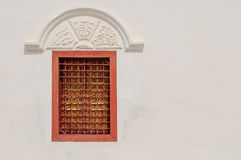 Thailand window. White wall with  closed red window Stock Photo