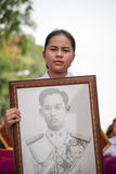 Thailand women,Thai girl were holding pictures of the king of Thailand. SURATTHANI,THAILAND ,OCTOBER 17 ,2016: Thailand women,Thai girl were holding pictures of Stock Photography