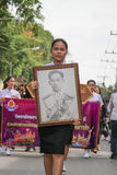 Thailand women,Thai girl were holding pictures of the king of Thailand. SURATTHANI,THAILAND ,OCTOBER 17 ,2016: Thailand women,Thai girl were holding pictures of Stock Photo