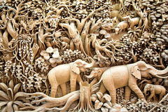 Thailand wood carving art. Section of an ancient mural wood carving art from Thailand. The production of things from a teak is very important for a country Royalty Free Stock Image