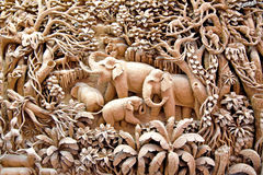 Thailand wood carving art. Section of an ancient mural wood carving art from Thailand. The production of things from a teak is very important for a country Stock Image