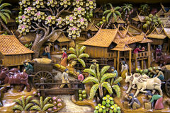 Thailand wood carving art. Section of an ancient mural wood carving art from Thailand. The production of things from a tic is very important for a country Royalty Free Stock Images
