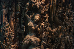 Thailand wood carving. Section of an ancient mural wood carving from Thailand stock image