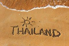 Thailand word on sandy beach background. Thailand word on sandy beach, travel background stock photos