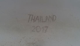 `Thailand 2017` written in the sand on the beach Royalty Free Stock Images