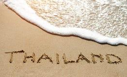 Thailand written on the sand beach near sea - travel holiday concept Stock Photography