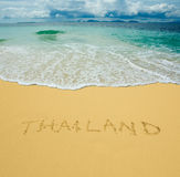 Thailand written in a sandy beach Stock Photography