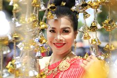Thailand young woman dressed in a standing pose with Bell`s good and there`s a scene in front of blur stock images
