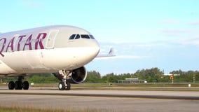 Thailland. Phuket International Airport. Airfield. Twin-engine aircraft start engines. Close-up. Slow Motion. Qatar. stock video footage