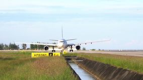 Thailland. Phuket International Airport. Airfield. Twin-engine aircraft start engines. Slow Motion. stock video footage