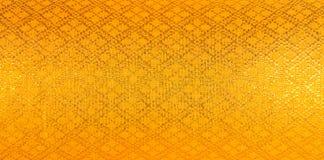 Thailändischer silk Goldfarbhintergrund Stockfoto