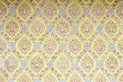 Thailändskt mönstra väggen Royaltyfri Foto