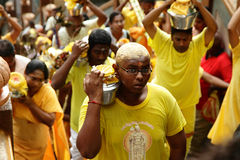 Thaipusam 2011. KUALA LUMPUR - 19 JANUARY 2011: Devotees carrying milk and other offerings to their deities as they climb up the stairs of Batu Caves during Stock Photography