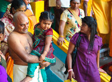 Thaipusam pilgrims and his family at Batu Cave, Malaysia Stock Image